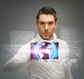 Man with tablet pc and virtual screens Royalty Free Stock Photo
