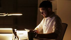Man with tablet pc working late night at office stock video footage