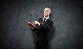 Man with tablet pc royalty free stock photography