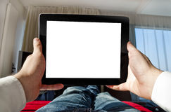 Man with tablet relaxing - point of view photo Royalty Free Stock Images