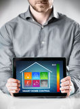 Man with Tablet Showing Home Control Display stock images