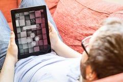 Man with tablet at sofa Royalty Free Stock Photos