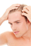 Man take care of his hair Stock Photography