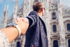 Man take for nand his girlfriend near the Duomo di Milano. Man take for hand his girlfriend near the Duomo di Milano Royalty Free Stock Photo