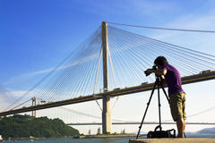 Man take photo of the bridge Stock Photo