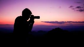 Man take a photograph during sunset Royalty Free Stock Photos
