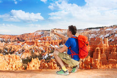 Man take picture with cell phone of Bryce Canyon Stock Photography