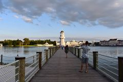 Man take a picture of lighthouse panoramic view and boardwalk at Lake Buena Vista area royalty free stock photography