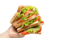 Man take a sandwich with  vegetables and bacon Royalty Free Stock Image