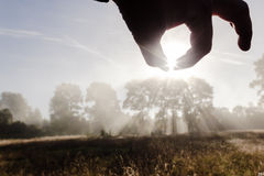 Man take sun in hands Royalty Free Stock Images