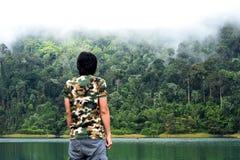 Man take a view of dense tropical rainforest at Rajjaprabha Dam or Cheow Lan Dam Guilin of Thailand Royalty Free Stock Image