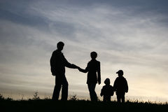 Man take woman with two children Stock Photography