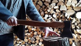 The man takes the ax.Slow motion stock footage