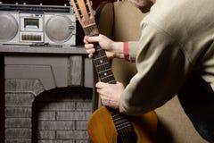 Man takes guitar. Royalty Free Stock Image