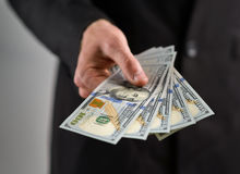Man takes  handful of money Royalty Free Stock Photos
