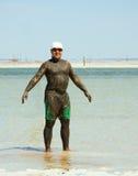 Man takes a mud bath Stock Photo