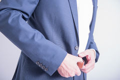 Man takes off his pants. jeans suit Royalty Free Stock Photos