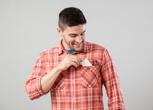 Man takes out blank business card from the pocket Royalty Free Stock Photography