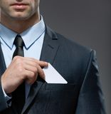 Man takes out business card from the pocket Stock Image