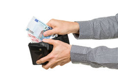 Man takes out Euro banknotes from wallet Stock Photo