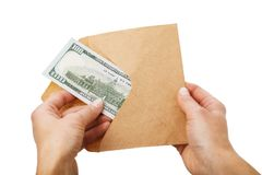 Man takes out one hundred dollars from an envelope, concept isolated on white background stock images
