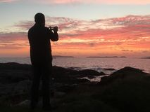 Man takes a photo of sunset royalty free stock photos