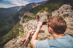 Man takes photo of woman outdoor. stock image