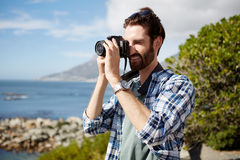Man takes pics of the ocean Royalty Free Stock Image