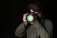 Man takes picture. Close up. Black background Royalty Free Stock Photos