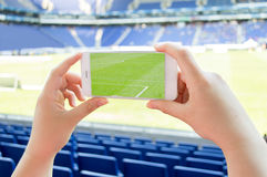 Man takes a picture the football stadium Stock Images