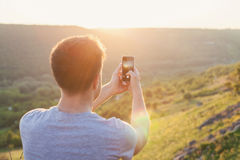 Man takes a picture by phone Stock Image