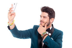 Man takes pictures with cellphone Royalty Free Stock Images