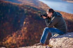 Man takes pictures of the landscape Royalty Free Stock Photo