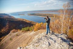 Man takes pictures of the landscape Stock Photo