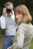 Man takes a pictures from woman Royalty Free Stock Image