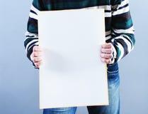 Man takes placard Stock Photos