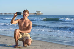 Man takes selfie at beach Royalty Free Stock Image
