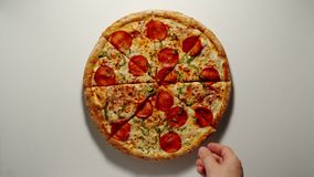 Man Takes A Slice Of Big Pizza From The Wooden Board
