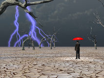 Man takes in storm under umbrella Stock Image