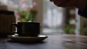 The man takes a teaspoon and stirs the sugar in a cup of coffee. slow motion, 1920x1080, full hd stock video