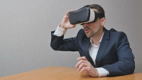 Man takes virtual reality glasses stock footage