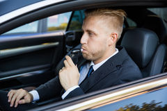 Man Taking Alcohol Text. Man Sitting Inside Car Taking Alcohol Test royalty free stock photos