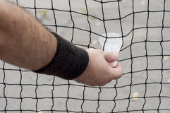 Man taking a badminton shuttlecock. Captive in the net Stock Images