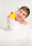 Man taking a bath Stock Photos