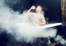 Man taking a bath Royalty Free Stock Photography