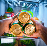Man taking beer from a fridge Royalty Free Stock Image