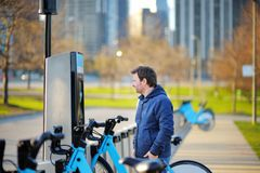 Man taking a bicycle for rent in Chicago Stock Photo