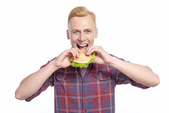 Man taking bite of sandwich Royalty Free Stock Photos