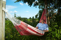 Man taking a break in a hammock Stock Photography