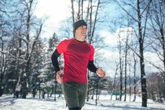 Man Taking Break From Running in Extreme Snow Conditions. Man Sportsman Taking Break From Running in Extreme Snow Conditions Royalty Free Stock Image